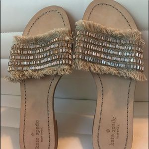 Slip on sandals with a big pop of bling